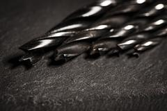 Stock Photo of Close up of drill bits on stone surface