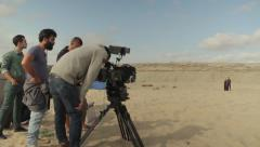 Stock Video Footage of Behind the scenes shooting the movie. The shooting scene in the desert