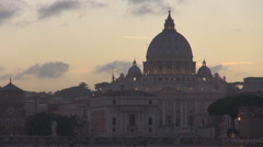 Saint Peters cathedral traffic street bridge Vatican sunset Rome church dome day Stock Footage