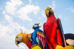 Statue blue and yellow macaw. - stock photo