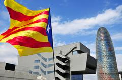 BARCELONA, SPAIN - SEPTEMBER 11: A pro-independence flag with the Agbar Tower - stock photo