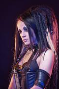 Beautiful demon girl with black eyes - stock photo