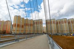 Stock Photo of Krasnogorsk, RUSSIA - April 18,2015. Pedestrian bridge is a built from two py