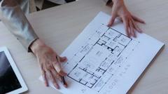Real estate broker showing apartment plan - stock footage