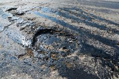 Road repair. Hole in  asphalt and bitumen Stock Photos