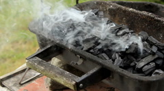 Smoke rising from charcoal placed in grill - close up Stock Footage