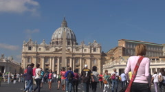 Tourist people enjoy Saint Peters cathedral large square Vatican Rome attraction - stock footage