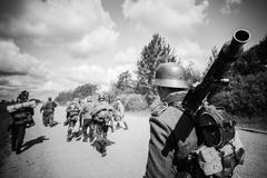 Unidentified re-enactors dressed as German soldiers are on a cou - stock photo
