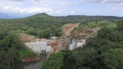 Building a dam in the jungle Stock Footage