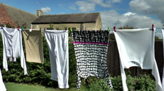 Washing blowing dry on a clothes line. Stock Footage