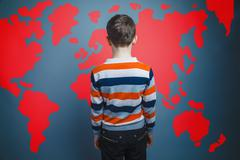 boy teenager European appearance Brown turned his back on a blac - stock photo