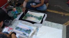 Street painter works in Jatujak Stock Footage