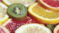 Different types of fruit slices of orange, grapefruit Stock Footage