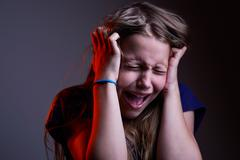 Portrait of unhappy screaming teen girl Stock Photos