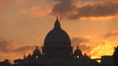 Amazing Vatican cupola silhouette sunset sunrise orange sky Rome dome emblem day Stock Footage