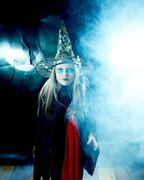 Attractive little witch girl in mystical fog Kuvituskuvat