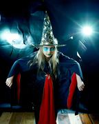 Stock Photo of Attractive which girlin spooky robe and hat