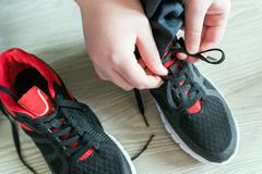 The boy running shoes  laces - stock photo