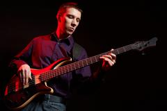 Portrait of musician with bass guitar Stock Photos