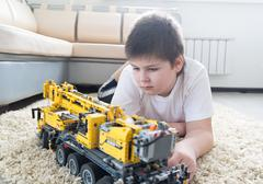 boy plays collects from the constructor of  car - stock photo