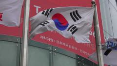 South Korea Flag Waving In Wind Infront Of Office Building Stock Footage