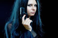 Beautiful goth girl with gun - stock photo