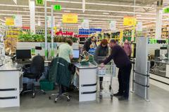 Stock Photo of MOSCOW, RUSSIA —MARCH 14: People pay for goods at  checkout in Leroy Merlin