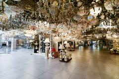 Many beautiful chandeliers light  store Stock Photos
