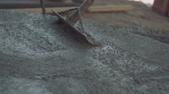Closeup of concrete tamping - stock footage