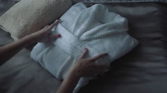 Women preparing bath robe Stock Footage