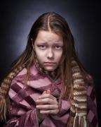 Stock Photo of Portrait of a miserable little girl