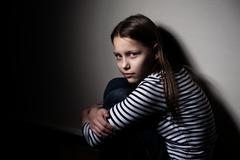 Portrait of a sad little girl Stock Photos
