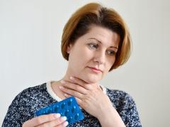 Adult woman with a sore throat Stock Photos