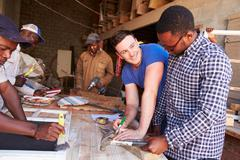 Men at work in a carpentry workshop, South Africa - stock photo
