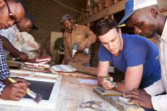 Men at work in a carpentry workshop, South Africa, close up - stock photo