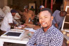 Portrait of man in a busy carpentry workshop, South Africa - stock photo