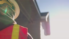 Low angle portrait of construction worker wearing safety gear on sunny day - stock footage
