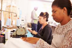 Women sewing at a community project workshop, South Africa Stock Photos