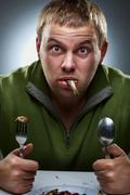 Portrait of hungry man - stock photo