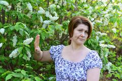 Adult woman with allergic diseases removed from wild cherry blossoms Stock Photos
