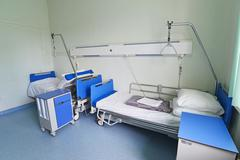 Hospital beds in hospital ward - stock photo