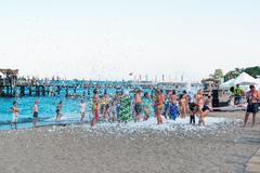 Kemer, Turkey-August 21, 2014. Foam Party on a resort. Group of people enjoyi - stock photo