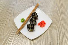 Sushi rolls,wasabi and ginger on  plate Stock Photos