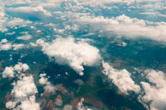 View of  land, fields, and clouds from above Stock Photos