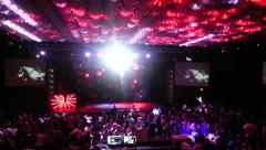 Crowd In Dark Theater And Red Lights On Celing Stock Footage