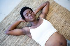 High angle view of relaxed pregnant woman lying Stock Photos