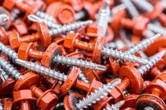 Many screws arranged as background - stock photo