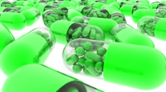Green capsules with vitamins and minerals. Tracking camera. 3d. - stock footage
