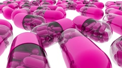 A lot of medical pills. Tracking camera. Pink pills. - stock footage