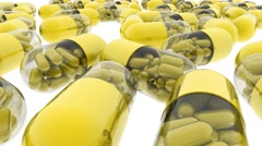 Yellow capsules with vitamins and minerals. Tracking camera. 3d. - stock footage